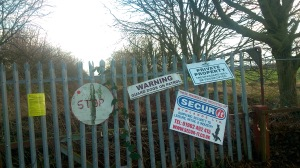 Signs warning of private land and guards, easy to get past